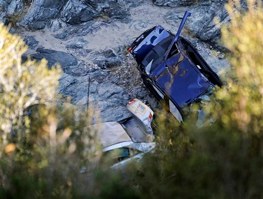 Two cars at the bottom of a remote mountain are recovered in Castaic, Calif., Friday, Sept. 30, 2011 .   David Lavau, whose car had plunged 200 feet off a remote mountain road, was found yesterday by his three adult children (AP)