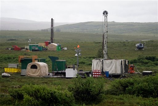 In this July 13, 2007 file photo, workers with the Pebble Mine project test drill in the Bristol Bay region of Alaska near the village of Iliamma, Alaska. (AP)