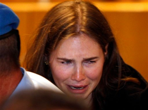 Amanda Knox breaks in tears after hearing the verdict that overturns her conviction and acquits her of murdering her British roommate Meredith Kercher, at the Perugia court, central Italy, Monday, Oct. 3, 2011.