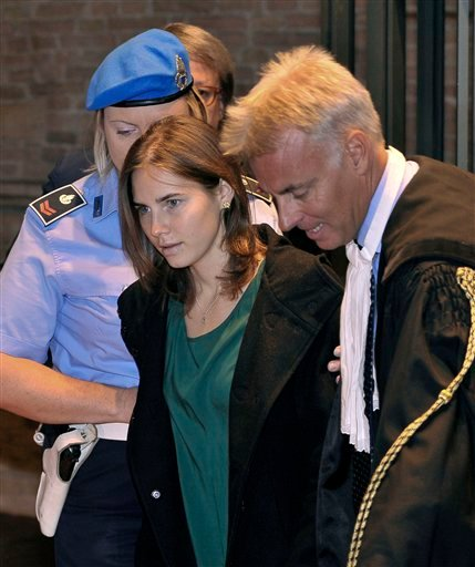 Amanda Knox, accompanied by her lawyer Carlo Dalla Vedova, arrives for an appeal hearing at the Perugia court, central Italy, Monday, Oct. 3, 2011.