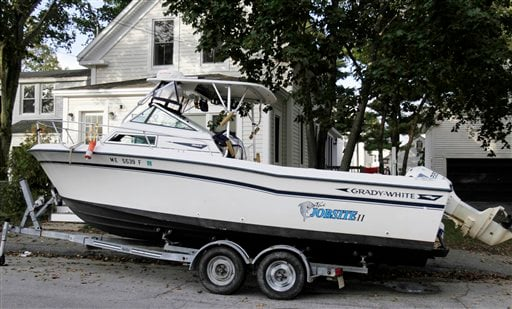 The 24-foot boat, Job Site 2, is parked in front of paraplegic skipper Nicholas Masi III's house in Biddeford, Maine on Monday, Oct. 3, 2011.