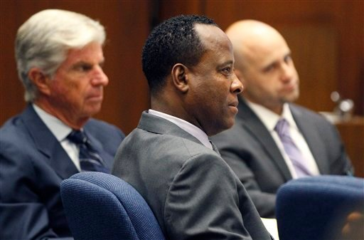 Dr. Conrad Murray, center, listens to testimony seated near his attorneys J. Michael Flanagan, left, and Nareg Gourjian during Murray's trial in the death of pop star Michael Jackson, Monday, Oct. 3, 2011, in Los Angeles.