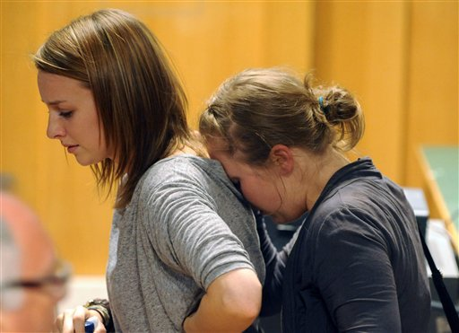 Amanda Knox's sister Deanna, left, reacts upon the verdict that overturns Amanda Knox conviction and acquits her of murdering her British roomate Meredith Kercher, at the Perugia court, Italy, Monday Oct. 3, 2011. (AP)