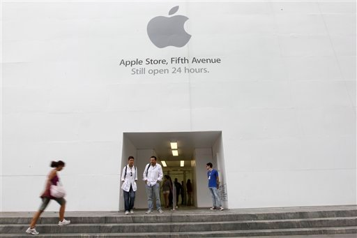 In this Aug. 25, 2011 photo, customers stand outside the Apple flagship store on Fifth Ave., in New York. Apple fans are amped.