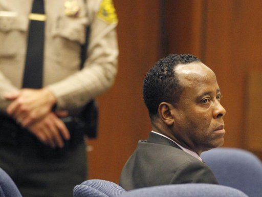 Dr. Conrad Murray sits in court during his trial in the death of pop star Michael Jackson in Los Angeles, Tuesday, Oct. 4, 2011.