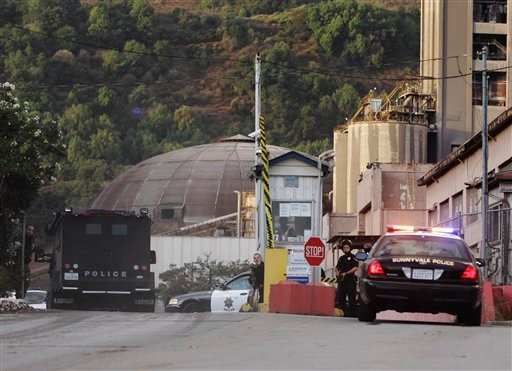 Police surround the entrance of the Lehigh Southwest Cement Company in Cupertino, Calif., Wednesday, Oct. 5, 2011. (AP Photo/Paul Sakuma)