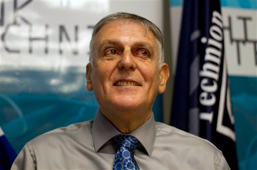 Israeli scientist Daniel Shechtman poses for photographers during a news conference at the Haifa Technion, Israel, Wednesday, Oct. 5, 2011. (AP Photo/Ariel Schalit)
