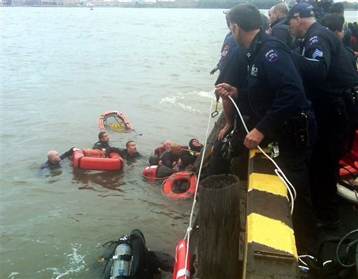 In this photo provided by the New York Police Department, divers work in the East River Tuesday, Oct. 4, 2011 in New York. (AP Photo/New York Police Department)