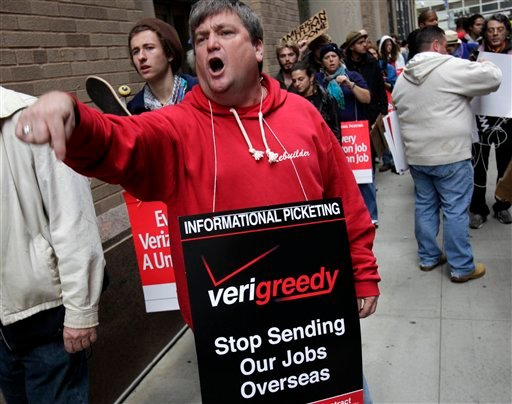 Kevin Condy and other picketing Verizon employees are joined by Occupy Wall Street protesters in front of a Verizon office in New York Oct. 4, 2011. (AP Photo/Seth Wenig)