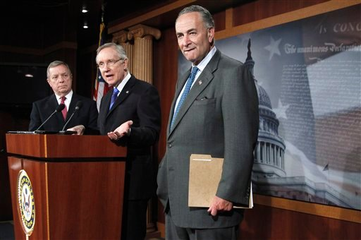 Senate Majority Leader Harry Reid of Nev., center, flanked by Senate Majority Whip Richard Durbin of Ill., left, and Sen. Charles Schumer, D-N.Y., speak about President Barack Obama's jobs bill Wednesday Oct. 5, 2011. (AP Photo/Manuel Balce Ceneta)