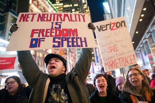 Demonstrators rally in support of net neutrality outside a Verizon store, Thursday, Dec. 7, 2017, in New York. The FCC is set to vote Dec. 14 whether to scrap Obama-era rules around open internet access that prevent phone and cable companies from favoring