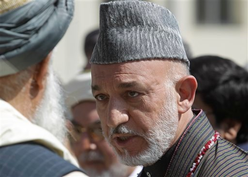 Afghan President Hamid Karzai talks to one of elders during the funeral ceremony of former president Burhanuddin Rabbani at the presidential palace in Kabul, Afghanistan, Friday Sept. 23, 2011.