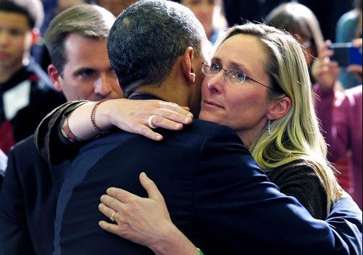 President Barack Obama embraces Scarlett Lewis, mother of Sandy Hook Elementary School shooting victim Jesse Lewis.