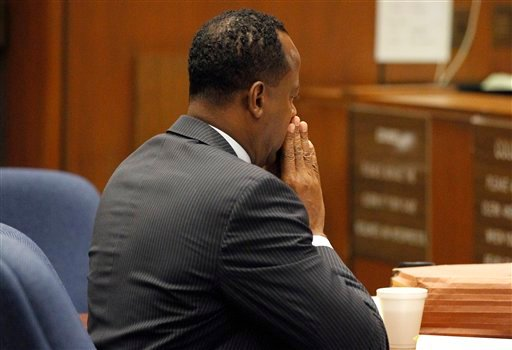 Dr. Conrad Murray sits at the defense table during his trial in the death of pop star Michael Jackson in Los Angeles, Wednesday, Oct. 5, 2011. (AP Photo/Mario Anzuoni, Pool)