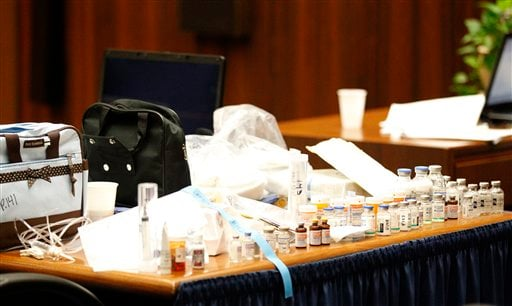 Drugs found in the home of pop star Michael Jackson by Los Angeles County coroner investigator Elissa Fleak sit on the prosecution's table after being introduced as evidence during Dr. Conrad Murray's trial in the death of Jackson in Los Angeles.