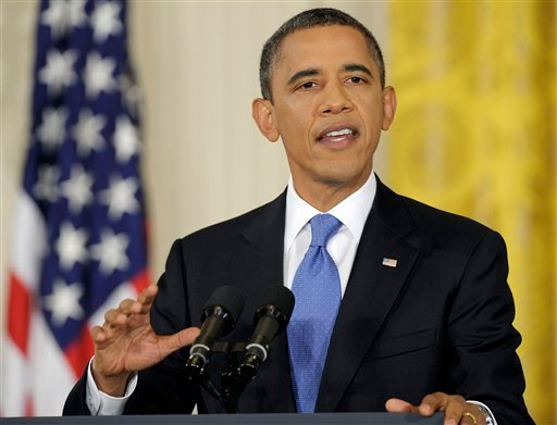 President Barack Obama gestures during a news conference in the East Room of the White House in Washington, Thursday, Oct. 6, 2011. (AP Photo/Susan Walsh)
