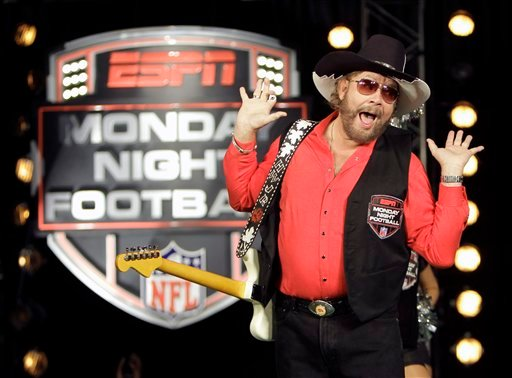 """In this July 14, 2011, file photo, Hank Williams Jr. performs during the recording of a promo for ESPN's broadcasts of """"Monday Night Football,"""" in Winter Park, Fla. (AP Photo/John Raoux, File)"""