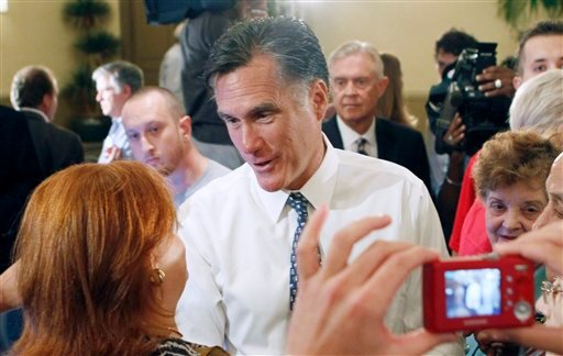 Republican presidential candidate, former Massachusetts Gov. Mitt Romney talks to a supporter after a town hall meeting in Miami, Wednesday, Sept. 21, 2011.
