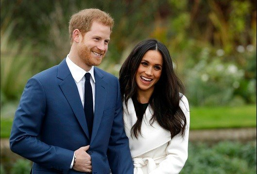 Britain's Prince Harry and his fiancee Meghan Markle pose for photographers.