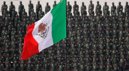 FILE - In this Sept. 13, 2016 photo, cadets attend a graduation ceremony at the Military Academy, in Mexico City. (AP Photo/Rebecca Blackwell, File)
