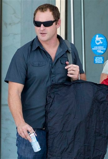 Petty Officer Nicholas Bickle walks out of the Lloyd George Federal Courthouse, Friday, Oct. 7, 2011, in Las Vegas.