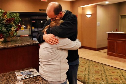 Deborah Bradley, left, and Jeremy Irwin embrace while in the lobby of an Hampton Inn hotel in Kansas City, Mo., Friday, Oct. 7, 2011.