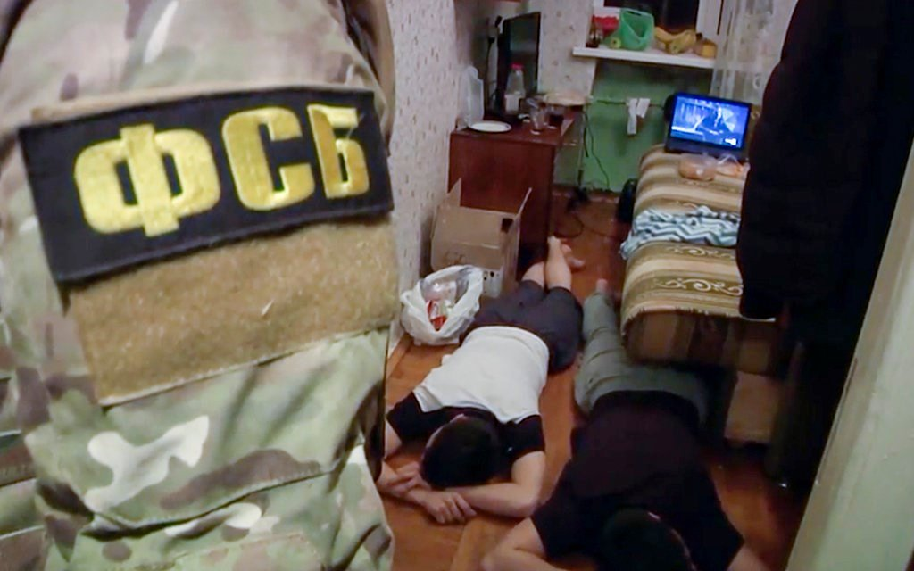 In this undated video grab, Russian Federal Security Service operatives detain a suspected member of the Islamic State group's cell in St. Petersburg (Russian Federal Security ServiceAP video via AP)