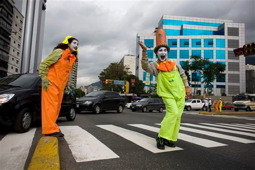 Mimes gesture as they stand in a crosswalk in Caracas, Venezuela, Friday Oct. 7, 2011. (AP)
