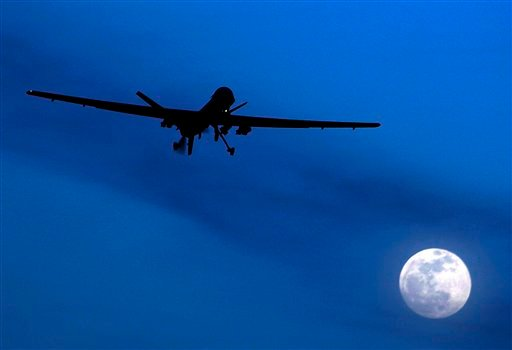 In this Jan. 31, 2010 file photo, an unmanned U.S. Predator drone flies over Kandahar Air Field, southern Afghanistan, on a moon-lit night. (AP)