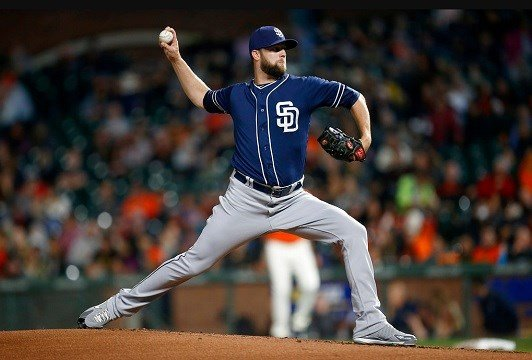 San Diego Padres pitcher Jordan Lyles throws to the San Francisco Giants during the first inning of a baseball game, in San Francisco.