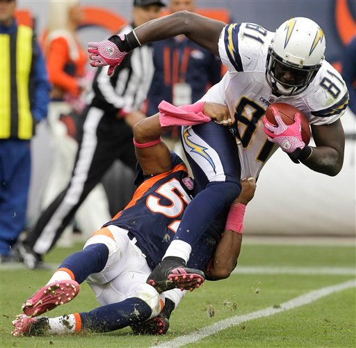 San Diego Chargers tight end Randy McMichael (81) is tackled by Denver Broncos defensive end Jason Hunter (52) in the fourth quarter.