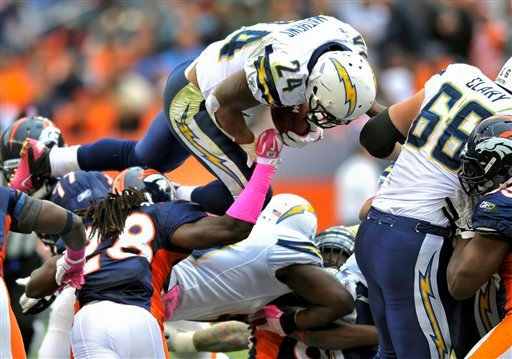 San Diego Chargers running back Ryan Mathews (24) leaps over the Denver Broncos offensive line.