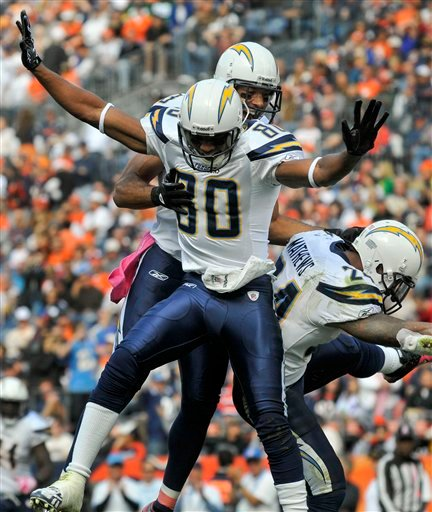 San Diego Chargers wide receiver Malcom Floyd (80) celebrates with wide receiver Vincent Jackson (83) and running back Ryan Mathews (24) after scoring a touchdown against the Denver Broncos in the second quarter.