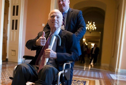 Sen. John McCain, R-Ariz., leaves a closed-door session where Republican senators met on the GOP effort to overhaul the tax code.