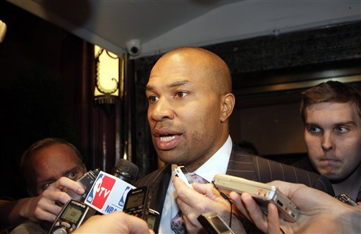 Derek Fisher, president of the NBA players' association, talks with reporters after leaving a meeting between NBA players and owners, Sunday, Oct. 9, 2011, in New York. (AP Photo/David Karp)