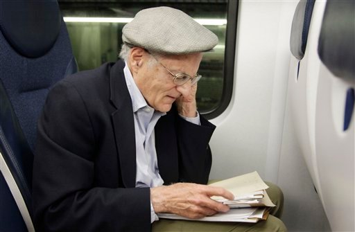American economist Thomas Sargent takes a phone call while seated on a train in New York Monday, Oct. 10, 2011, shortly after learning that he and fellow American Christopher Sims had won the Nobel Prize for Economics. (AP)