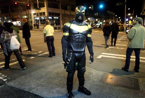 FILE - This Feb. 18, 2011 file photo shows Seattle superhero Phoenix Jones during a patrol of Seattle's Capitol Hill neighborhood.