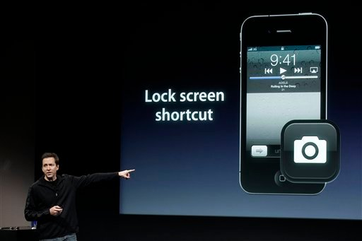 FILE - In this Oct. 4, 2011 file photo, Apple's Scott Forstall, talks about camera on the Apple iPhone 4S during an announcement at Apple headquarters in Cupertino, Calif.