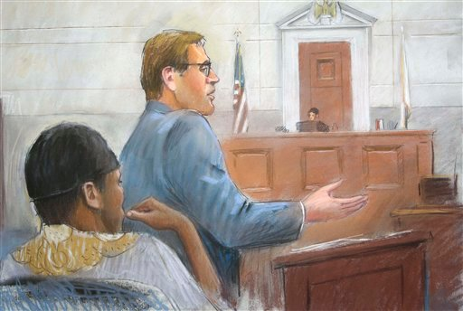 In this courtroom drawing, Umar Farouk Abdulmutallab, left, listens as Assistant U.S. Attorney Jonathan Tukel presents opening arguments in U.S. District Judge Nancy Edmunds' courtroom in Detroit, Tuesday, Oct. 11, 2011.
