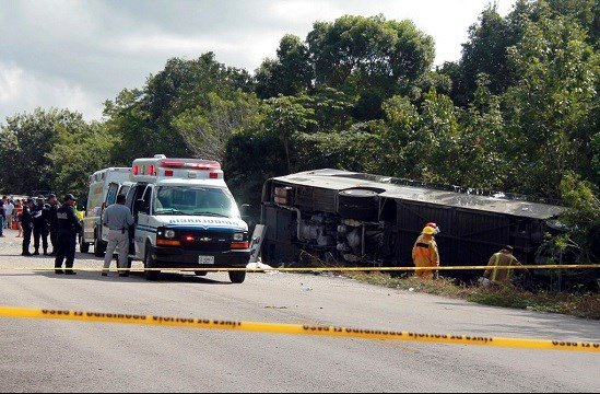 An ambulance sits parked next to an overturned bus in Mahahual, Quintana Roo state, Mexico.