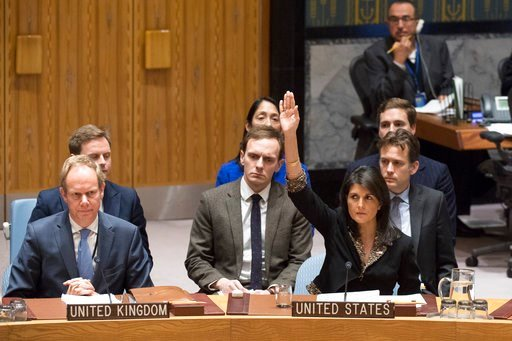 In this Monday, Dec. 18, 2017 photo, U.S. Ambassador to the United Nations Nikki Haley, right, votes against a resolution concerning Jerusalem's status at U.N. headquarters.(Eskinder Debebe/United Nations via AP)