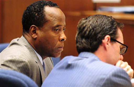 Dr. Conrad Murray listens in court during his involuntary manslaughter trial, Tuesday, Oct. 11, 2011, in downtown Los Angeles.