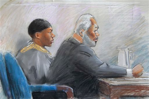 In this drawing, Umar Farouk Abdulmutallab sits next to Anthony Chambers, a lawyer who is assisting in Abdulmutallab's defense in U.S. District Judge Nancy Edmunds' courtroom in Detroit Oct. 11, 2011. (AP Photo/Jerry Lemenu)