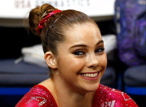 McKayla Maroney smiles after competing on the floor exercise during the U.S. women's national gymnastics championships in Hartford, Conn.