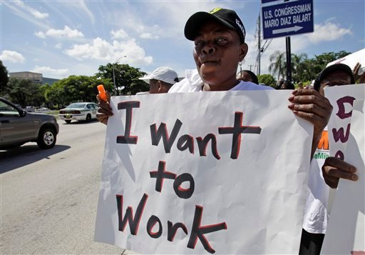 Desermithe Cyrius demonstrates for jobs outside of the offices of U.S. Sen. Marco Rubio, R-Fla., Wednesday, Oct. 12, 2011, in Doral, Fla.