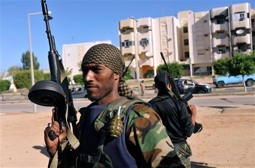 Libyan revolutionary fighters control downtown Sirte, Libya, Wednesday, Oct. 12, 2011.