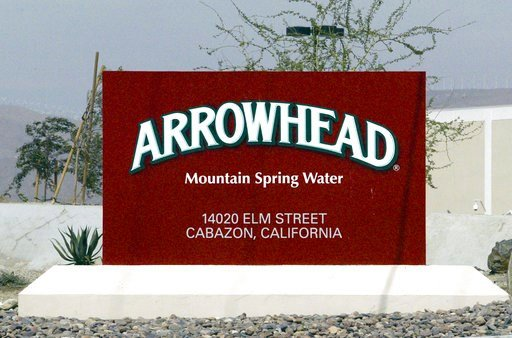 FILE - In this July, 7, 2004, file photo, a sign at the entrance to the Arrowhead Mountain Spring Water Company bottling plant, owned by Swiss conglomerate Nestle, on the Morongo Indian Reservation near Cabazon, Calif. AP