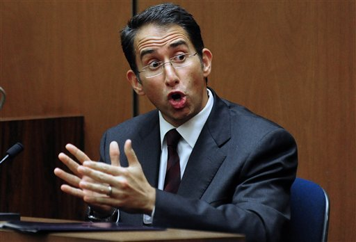 Dr. Nader Kamangar gestures while speaking on the witness stand during Dr. Conrad Murray's involuntary manslaughter trial, Wednesday, Oct. 12, 2011, in downtown Los Angeles.