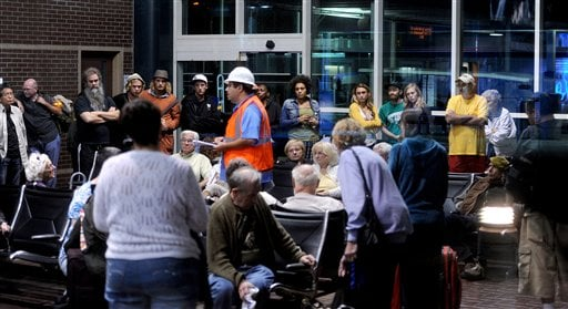 Stranded Amtrak passengers gather after two trains collided in an Oakland, Calif., station on Thursday, Oct. 13, 2011. (AP Photo/Noah Berger)