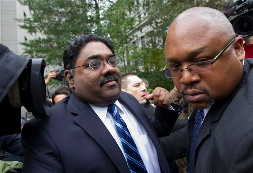 Raj Rajaratnam, co-founder of Galleon Group LLC, left, leaves Federal Court after his sentencing on Thursday, Oct. 13, 2011 in New York. (AP Photo/Jin Lee)